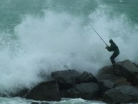 Fishing Storm Rocks Stock Video Footage