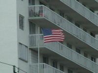 American Flag in Storm Winds Stock Video Footage